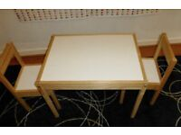 Wooden table and two chairs suitable for 2-3 year olds in nursery or kitchen. In very good condition