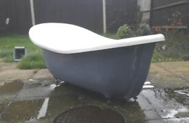Blue roll top bathtub