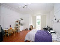 INCLUSIVE IF GAS, WATER AND HEATING BILLS, VERY LARGE STUDIO FLAT WITH DIRECT ACCESS TO GARDEN.