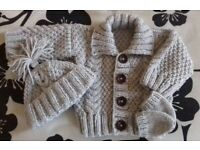 Brand new hand made Aran baby cardigan hat and mittens sets
