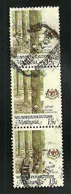 MALAYSIA USED STAMPS - VERTICAL STRIP OF 3 USED RUBBER TREE STAMPS