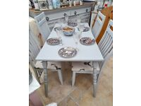 lovely 4 ft, dove grey table with 4 x designer chairs, upholstered in stag material
