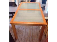 Dining table with frosted glass