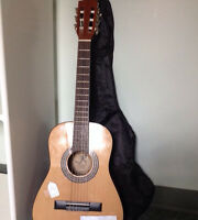 Small Reynolds classical guitar