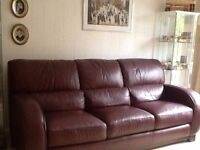 Red leather three seater settee with matching leather footstool