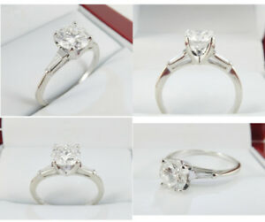 1.12ct Solitaire Engagement Ring with tapered Baguette Diamonds