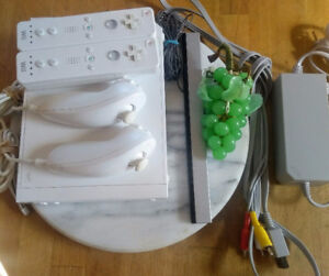 Console wii + wii board 3manettes, 1nunchuk 6 jeux