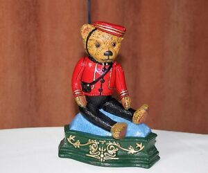 TeddyBear Doorstop Cast Iron Bellhop Cheery on floor or dresser