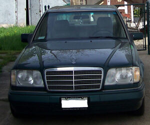 Classic Mercedes E320 with inline 6 cylinder engine for sale.