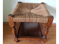 Vintage seagrass stool with underneath shelf