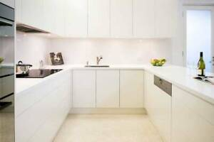 Kitchen cabinets in a galley design with 2 pack white doors Moorabbin Kingston Area Preview