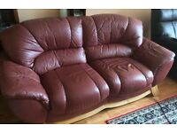 Two Seater Leather Settee.