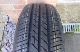 Spare wheel with unused Goodyear Eagle Touring 195/65r15 tyre and extras