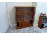 Teak bookcase with glass sliding doors very good condition