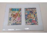 6 iron man comics in display frames