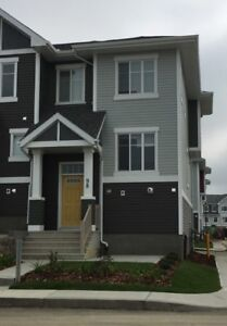 3 Year old end unit walk up townhouse with bright interior
