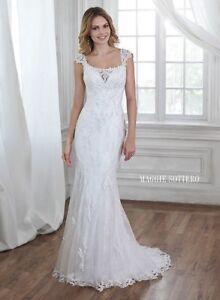 New designer wedding dress unaltered never worn.