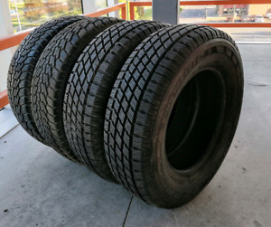 Set of four 195/70/14 winter tires. Excellent condition