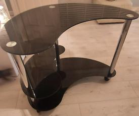 Black Glass / Silver Computer unit/table. Swivel lock wheels.