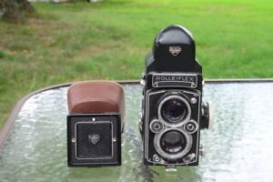 rolleiflex 3.5 xenotar with prism and waist level finders and rolleiflex strap