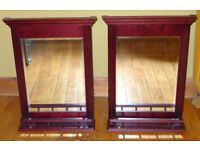 Pair of mirrors with dark wood frames and display shelves