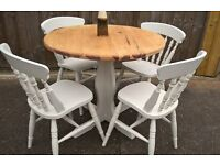Farmhouse theme pine kitchen table with 4 matching chairs, hand painted finish.