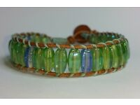 Handmade. New iridescent green and turquoise bevelled beads on natural leather.