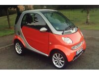 Smart car for sale only 23000 miles.