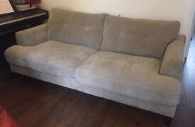 Grey 3 seater sofa with dark wood legs