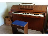 Mini Eavestaff Piano and stool. All keys work but will need tuning. Normal wear and tear for age.