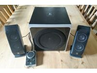 Logitech Z4 Speaker System. Two speakers, Bass Unit, and Remote Control