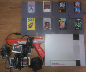 Nintendo NES with 8 games, 2 controllers, zapper and all hookups
