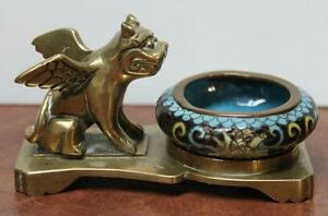 Brass figure of a kylin with cloisonne bowl