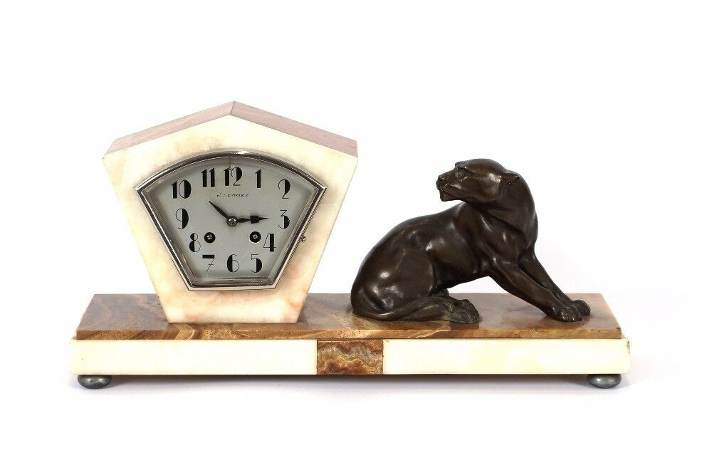 Art Deco marble mantel clock by Jacques, decorated with a spelter figure of a recumbent panther