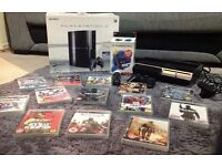 Playstation 3 with 13 games, controller and Playstation move starter pack!