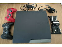 PS3 Slim + 2 controllers + charger