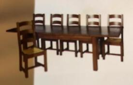 5-8ft extending table and 8 chairs