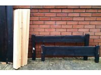wide single or small double bed frame, 114cm x 201cm. wooden frame and slats. In good condition.