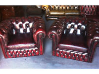 Pair of Oxblood leather club chairs