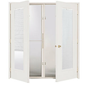 2 New 6ft wide Masonite Garden Doors - Will install for $400