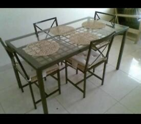 Ikea glass dining room table and 4 chairs
