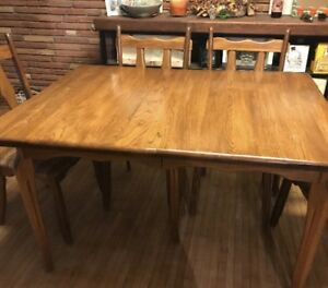 Solid wood dining room table with chairs