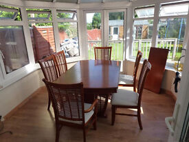 Large extendable table and six chairs
