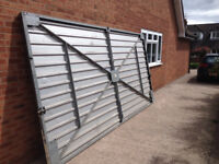 Double garage door in galvanised steel.