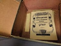 Vintage 'Mozart' 32 bass Accordion case and 1930s lesson books