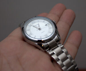 Comtex watch with stainless steel band