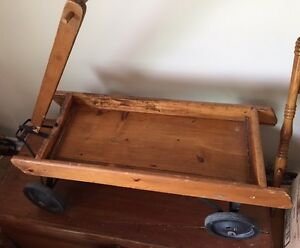 Antique wooden wagon which was once Red