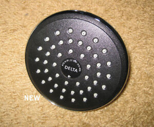 "Delta rain can Shower head 5 "" dia. New."