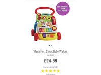 Vtech first steps walker and vtech play and learn activity table