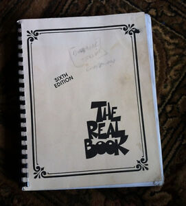 The Real Book (6th), 2 other music books.